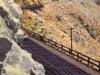 Train Skirting Mountain